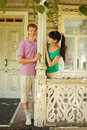 Couple pose on terrace village house Stock Images