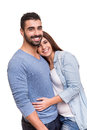 Couple posing over white background young love hugging Stock Images