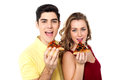 Couple posing with pizza slice about to eat boy and girl each holding of yummy Royalty Free Stock Photography