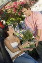 Couple with potted flower in garden centre Stock Image
