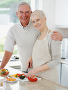 Couple preparing food in the kitchen Royalty Free Stock Photos