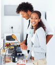 Couple preparing food together at home Royalty Free Stock Photo