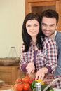 Couple preparing a healthy meal young Stock Images