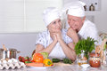 Couple preparing salad elderly vegetable together Stock Images