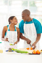 Couple preparing salad loving afro american green in kitchen Royalty Free Stock Photo
