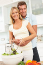 Couple Preparing Salad In Modern Kitchen Stock Photos