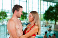 Couple in public swimming pool Stock Photography