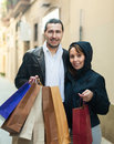 Couple with purchases at street smiling Royalty Free Stock Photo