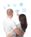 Couple pushing icons on a touch screen interface Royalty Free Stock Image