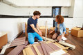 Couple putting together self assembly furniture in new home having a disagreement Stock Image
