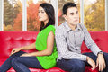 Couple quarreling and sitting separately asian on sofa after at home Royalty Free Stock Photography