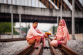 Couple on railway track newly wedded posing Stock Photos
