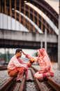 Couple on railway track newly wedded posing Stock Photo
