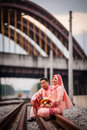 Couple on railway track newly wedded posing Royalty Free Stock Image