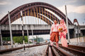 Couple on railway track newly wedded posing Royalty Free Stock Photo