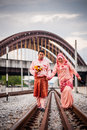 Couple on railway track newly wedded posing Royalty Free Stock Photography