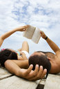 Couple reading book in holiday Royalty Free Stock Photo