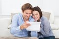 Couple reading letter at home happy together Stock Photos