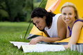 Couple Reading Map in Tent Stock Image