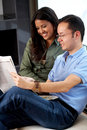 Couple reading a newspaper Stock Photography
