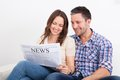 Couple reading newspaper Royalty Free Stock Photo