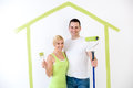 Couple ready to painting their home portrait of smiling young Stock Images