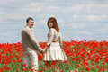 Couple on red poppies field Royalty Free Stock Images