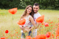 Couple in red poppies Royalty Free Stock Photo