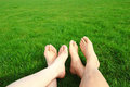 Couple relax barefoot enjoy nature in the green lawn Stock Photos