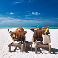 Couple relax on a beach at Maldives Royalty Free Stock Photos