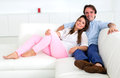 Couple relaxing at home Royalty Free Stock Image