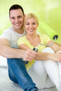 Couple relaxing after painting cute their new home Stock Images