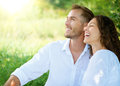 Couple relaxing in a park happy smiling Stock Images