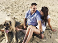 Couple relaxing with pet dog on the beach overhead shot of a Stock Photography