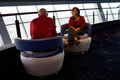 Couple relaxing at the stratosphere las vegas and talking in modern chairs in Stock Photo