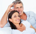 Couple relaxing together over white background Stock Photography