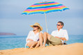 Couple relaxing on tropical beach happy romantic middle age vacation concept Stock Images