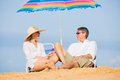 Couple relaxing on tropical beach happy romantic middle age vacation concept Royalty Free Stock Photos