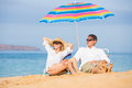 Couple relaxing on tropical beach happy romantic middle age vacation concept Stock Photos