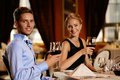 Couple in a restaurant beautiful young with glasses of wine Royalty Free Stock Photography