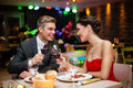 Couple in restaurant toasting affectionate at romantic atmosphere Stock Image