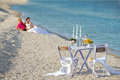 Couple resting on the beach romantic young wedding table in focus Stock Photography