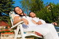 Couple resting in deck chair in summer Royalty Free Stock Photos