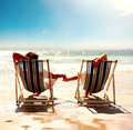A couple resting on the deck chairs Royalty Free Stock Photos