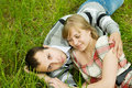 Couple resting on grass Stock Images