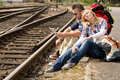 Couple resting looking at map railroad backpack Royalty Free Stock Image