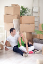 Couple resting from moving in new home young into a Stock Photo