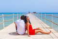 Couple resting on the pier of red sea egypt Stock Images