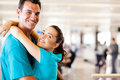 Couple reunion at airport Royalty Free Stock Photography