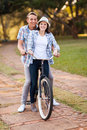 Couple riding bicycle loving teenage together outdoors Royalty Free Stock Photography